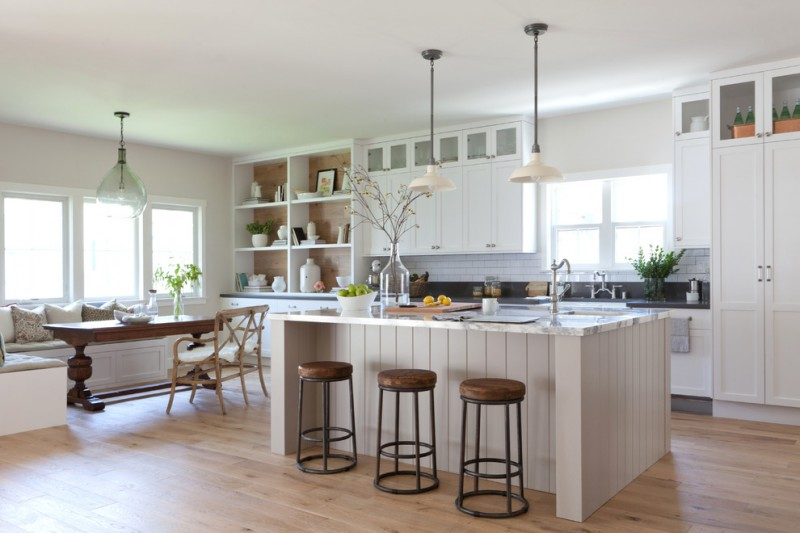 Large farmhouse galley open concept kitchen idea with shaker cabinets white cabinets backsplash subway tile baksplash marble countertops medium tone hardwood floors an island