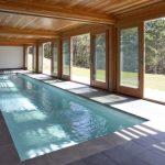 Mid Century Pool Idea With Wood Enclosure And Sliding Glass Doors Dark Grey Tiles Floors Simple Rectangular Pool White Walls