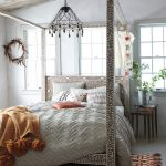 anthropologie style bedding hand tinkered chandelier bone inlay four poster bed mother of pearl nesting table temple bells throw textured chevron duvet tasseled chanda rug