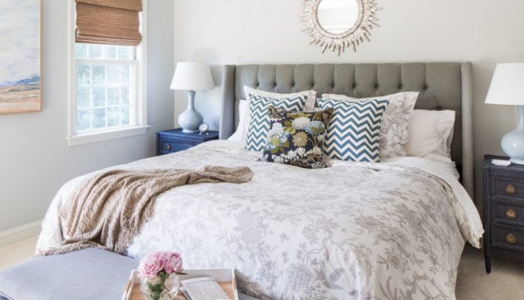 anthropologie style bedding transitional bedroom unique mirror gray puffy button stuffed headboard colorful pillows three drawer nightstand