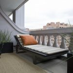 apartment balcony furniture chaise longue carpet decorative plants pillow contemporary area