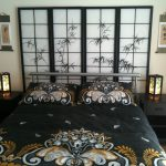 asian inspired bedding black bedside tables kanji pillows screen lamps drawer shelf beautiful bedroom