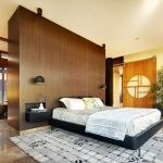 asian inspired bedding carpet pillows modern lamps sliding door window decorative plant ceiling light bedroom