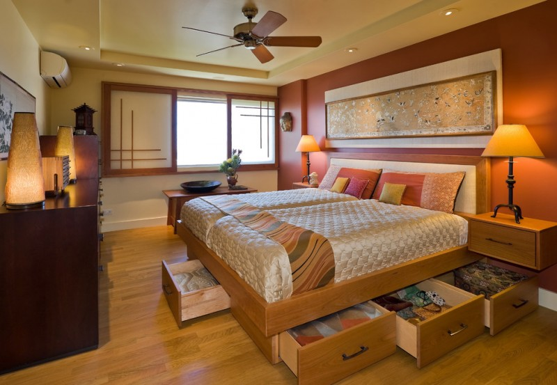 asian inspired bedding wood floor drawers pillows lamps air conditioner wall decor window ceiling fan bedroom