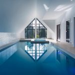 Attic Style Enclosure For Interior Pool With Glass Window White Walls And Tile Floors