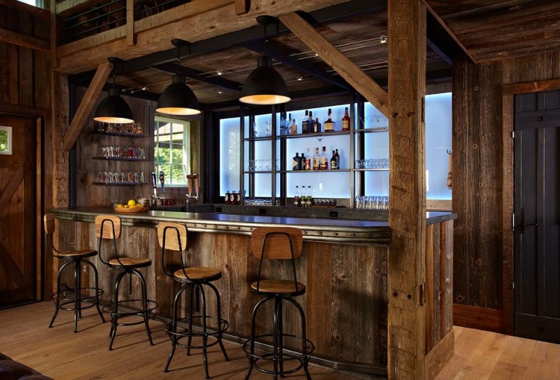 bar style kitchen table dark wood cabinets glass panels LED lights stools hardwood floors island wood countertops pendants hanging shelves farmhouse design