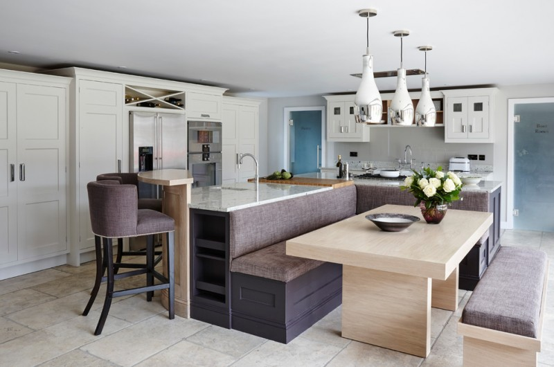 bar style kitchen table granite countertops benches island flat panel cabinets low back chairs undermount sink pendants backsplash ceramic floors contemporary design