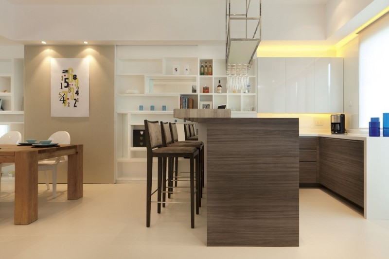 bar style kitchen table white cabinets backsplash grain countertops stools chairs standing shelves beige floors ceiling lights contemporary design