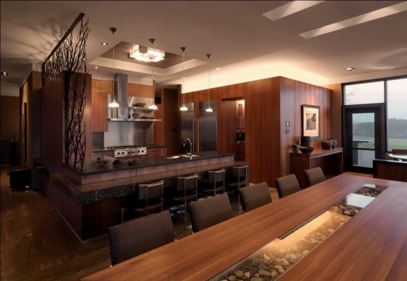 bar style kitchen table wood countertops flat panel cabinets undermount sink kitchenette stools chairs ceiling lamp pendants hardwood floors rustic design