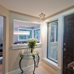 Baseboard Trim Style Glass Top Table Chairs Ceiling Lights Flowers Windows Door Contemporary Style