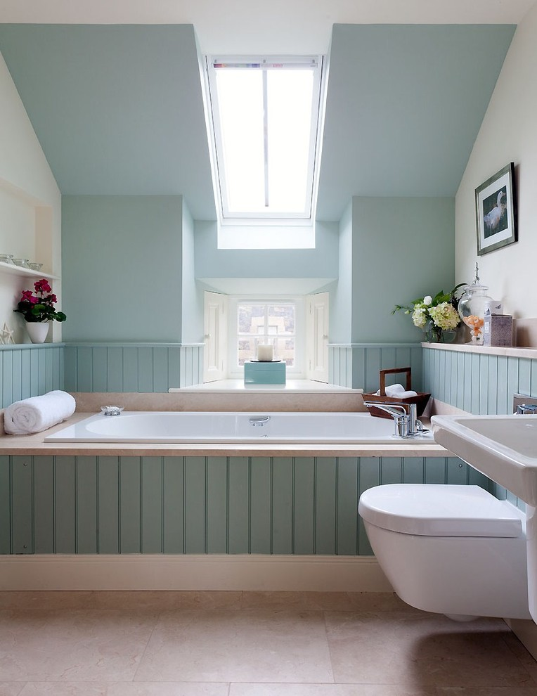 bathroom color trends green panel toilet hanging shelf windows tub pedestal sink transitional design