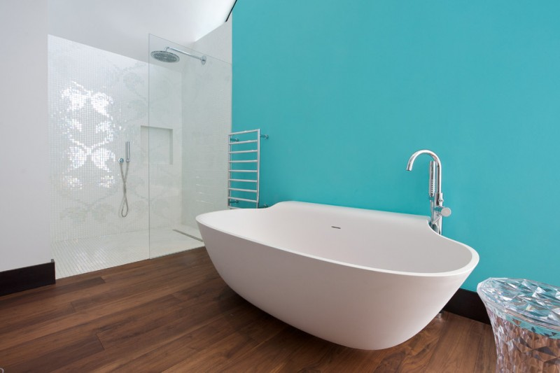 bathroom color trends hardwood floor blue wall bathtub rack shower contemporary style