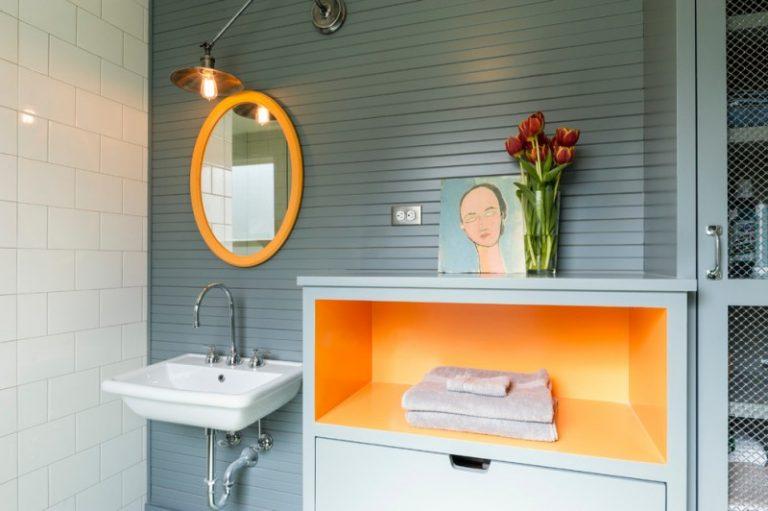 Bathroom Color Trends Wall Mounted Sink Round Mirror Hanging Lamp Orange Shelf White Tile Grey Backsplash