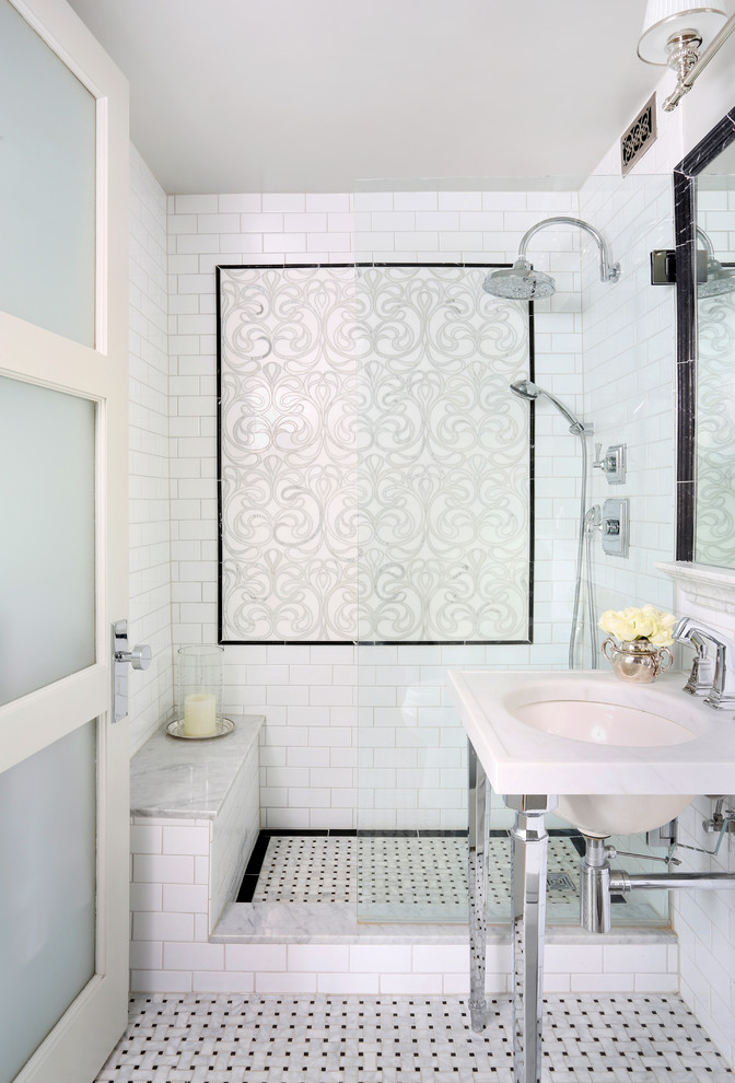 bathroom with shower without a door with subway tiles on the wall with accent tiles, tiles on flooring, built in bench, white sink with metal legs