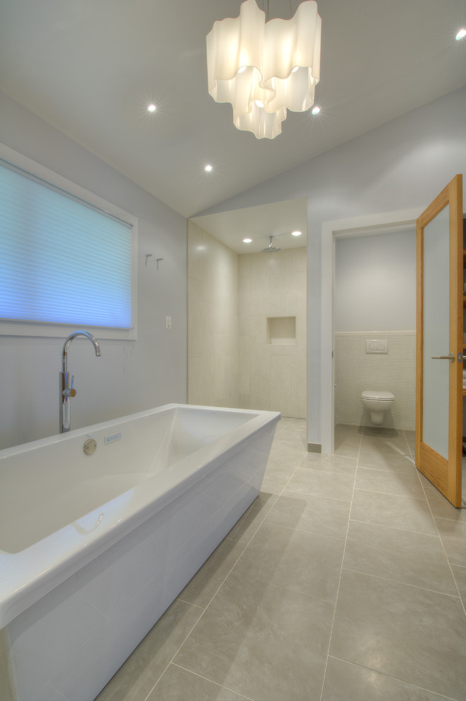 bathroom with three separated area for bathtub, toilet, and walk in shower with cream tiles