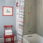 Beach Themed Bathroom Idea Beige Walls Light Blue Wall With Wall Art Multicolored Mosaic Tiles Floors Whirpool Bathtub In White Red Chair Multicolored Shower Curtain With Stainless Steel Curtain Rod