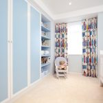 blue cupboard colored curtains teddy bear blue wall white crib white wall cream rug children chair