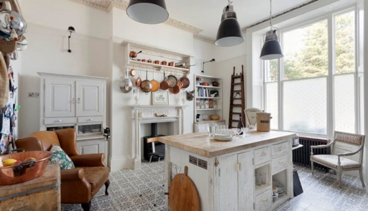 boho chic furniture kitchen island cabinet shelves armchair ladder books pendant lights