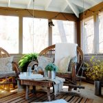 boho chic furniture lamps interesting chairs low table carpet decorative plants big windows rustic porch