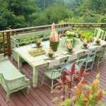boho chic furniture wood floor railing rustic deck chairs table bench flowers