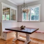 Breakfast Nook Benches Candle Holder Pendant Wood Table Brown Walls Island Light Hardwood Floors Plate Centerpiece Farmhouse Design