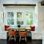 Breakfast Nook Benches Shaker Cabinets Island Quartzite Countertops Chairs Dark Hardwood Floors Pendants Wall Decorations Farmhouse Style