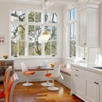 Breakfast Nook Benches Shaker Cabinets Round Table Modern Pendant Low Back Chairs Medium Tone Hardwood Floors Farmhouse Style