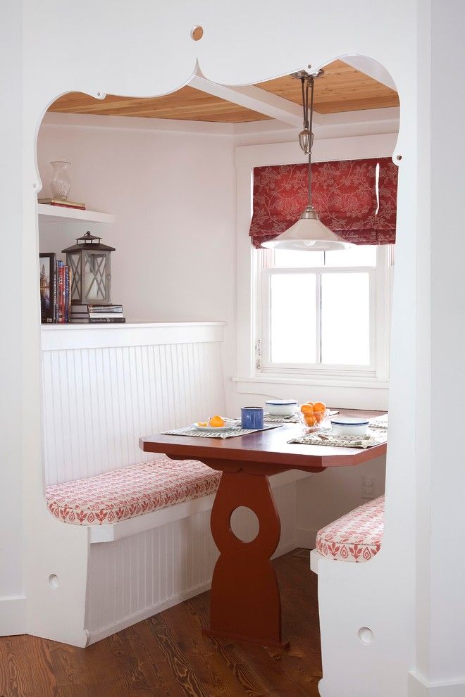 breakfast nook benches wood table white pendant hanging shelves lantern books curtains hardwood floors farmhouse style