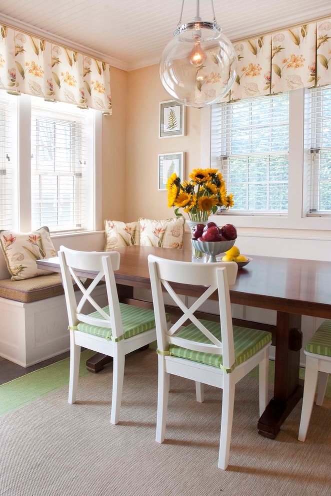 breakfast nook benches wooden table tall back chairs flower centerpiece throw pillows beige walls dark hardwood floors wall decorations farmhouse design