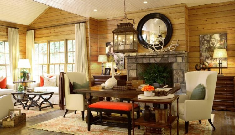 brick fireplace wall mounted mirror wooden wall wooden ceiling wooden floor classic hanging lamp white sofa wooden table