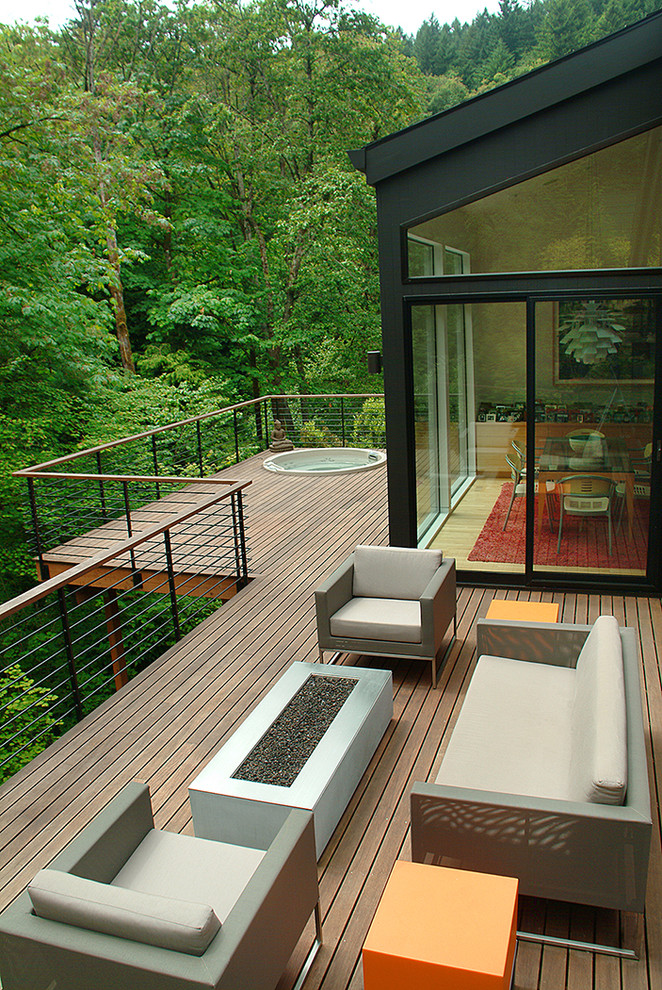 built in hot tub on the balcony with wooden flooring