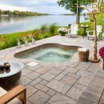built in hot tub with brown tiles pavers