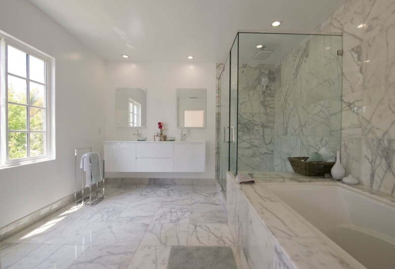 carrera marble bathrooms ceiling lights undermount cabinets alcove shower built in tub glass doors white tiles standing towel rack contemporary design