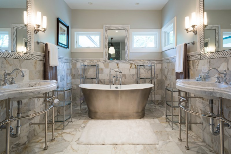 carrera marble bathrooms integrated sinks freestanding tub modern pendants wall lamps stone tiles faucets mirrors transitional design