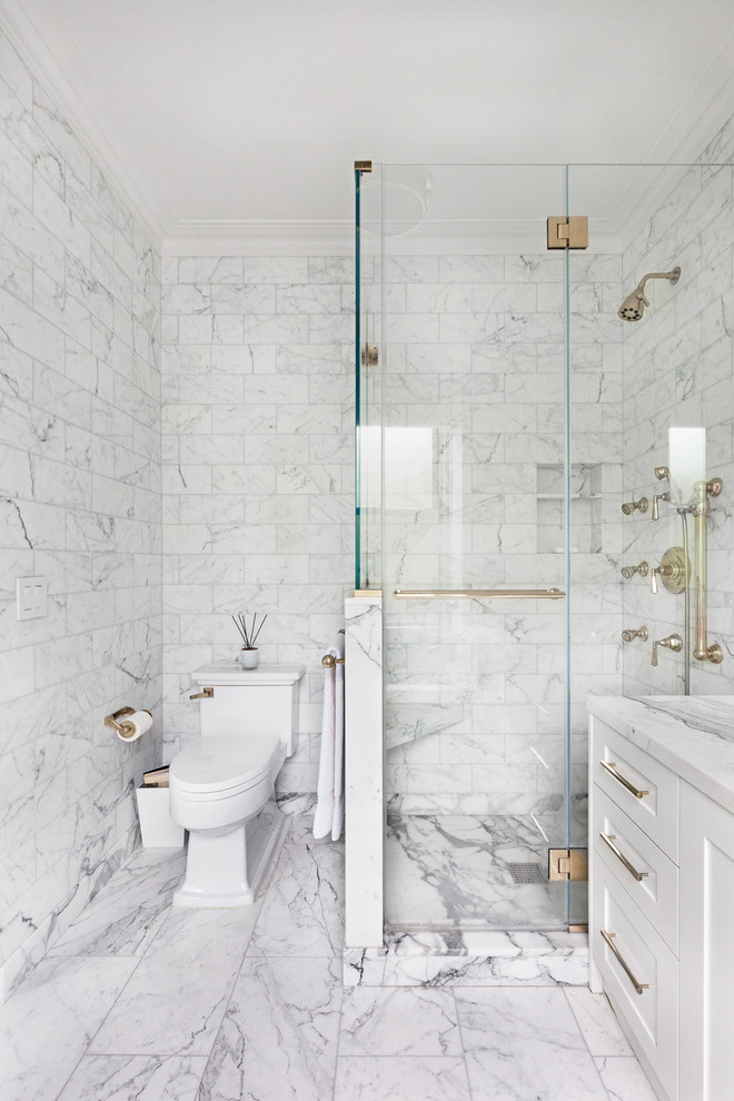 carrera marble bathrooms shaker cabinets two piece toilet hinged glass door alcove shower white tiles grey backsplash contemporary design
