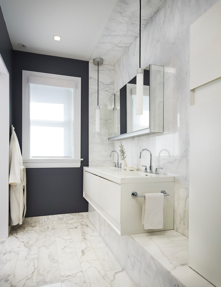 carrera marble bathrooms white tiles black walls flat panel cabinets hanging towel rack undermount sink faucets lamps modern design