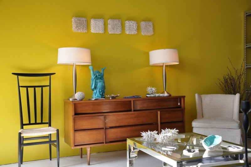 clean yellow wall painting idea wood console table in classic style light grey armchair black painted wood chair with linen seater glass top center table white floors