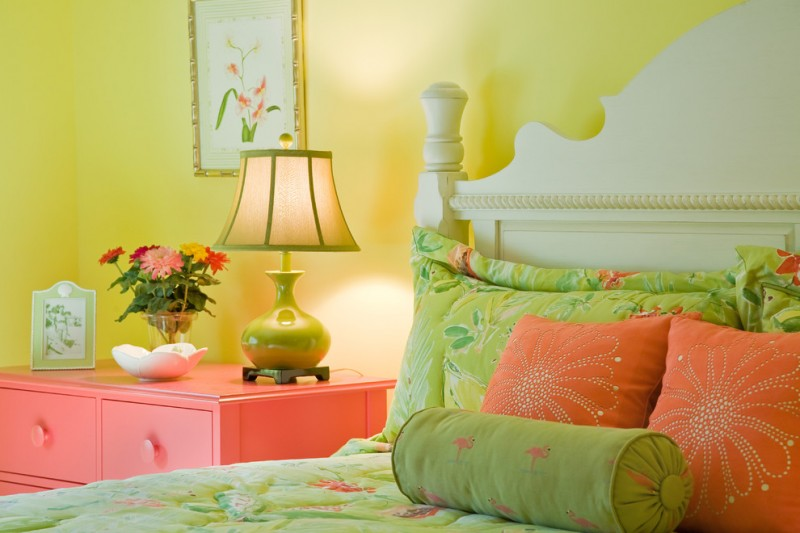 color to paint your bedroom yellow wall bed pillows bedside table drawer lamp flowers painting eclectic room