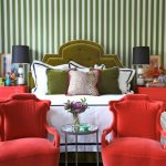 colors to paint your bedroom curtains with floral patterns green and white walls bed pillows red chairs bedside tables lamps paintings flowers eclectic room