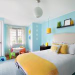 colors to paint your bedroom light blue walls white ceiling carpet hanging lamps bed pillows bedside table small chairs windows curtains wall decor shelf contemporary room