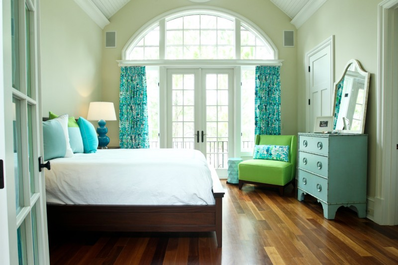 colors to paint your bedroom pale green walls bed pillows mirror wood floor doors windows curtains lamp beach style bedroom