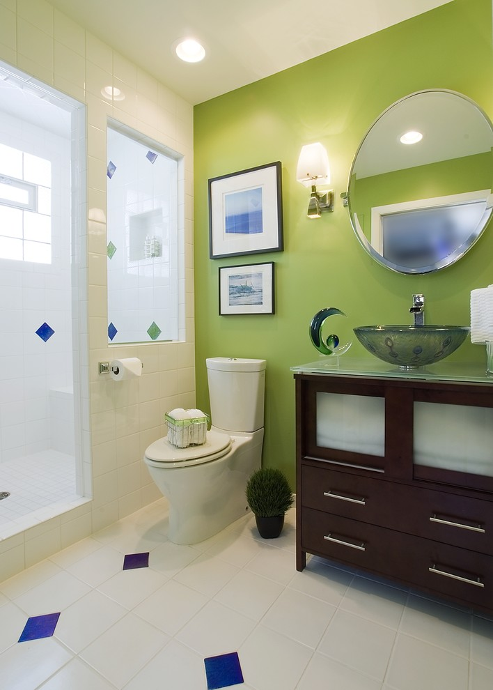 contemporary bathroom with green wall white ceramic tiles walls white ceramic floors two piece toilet dark wood vanity ultra glass vessel sink round shaped mirror