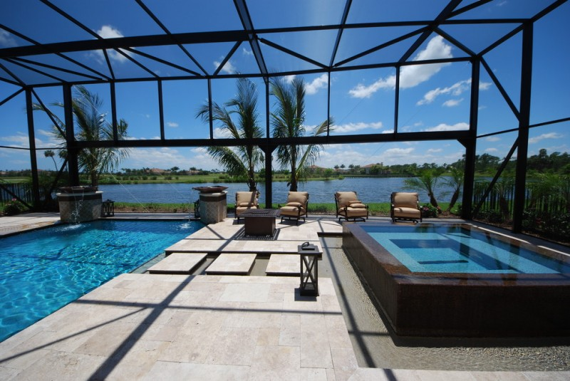 contemporary interior pool with glass enclosure square shaped pool smaller and higher pool concrete floors beige toned exterior furniture