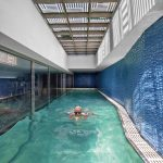 Contemporary Pool Enclosure Idea Textured And Blue Wall Frameless Glass Wall