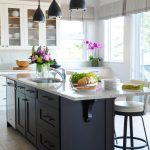 Dark Finished Wood Kitchen Island With Pull Out Cabinets & Drawers And Granite Top Bronze Pendant Lamps Modern Bar Stools