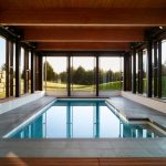 Dark Toned Cedar Enclosure For Modern Minimalist Interior Pool Natural Stone Paver Flooring Idea Fulll Glass Windows With Black Painted Frames
