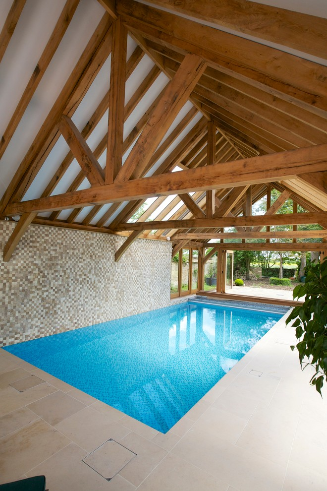 farmhouse styled pool enclosure with beams and mosaic tiles walls pale beige tiles flooring simple rectangular pool