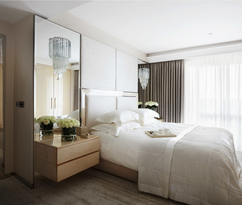 floor to ceiling mirror bed pillows flowers curtains cool floor contemporary bedroom