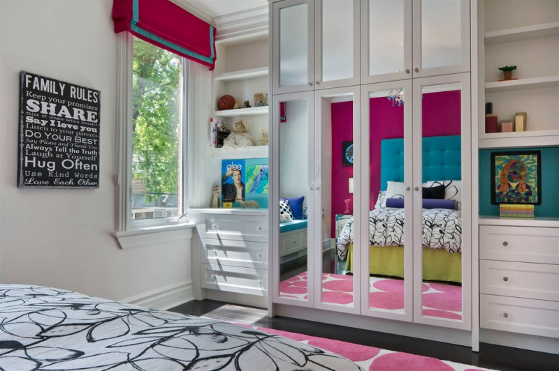 floor to ceiling mirrored closet doors pink accent rug pink and blue curtain black and white tile floors wall art work