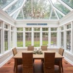 furniture for sunrooms glass window door and ceiling bright wooden floor rattan chairs